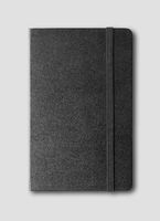 black closed notebook isolated on grey