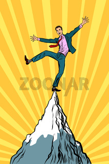 businessman at the top of the mountain