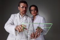 Two scientists with futuristic tablet