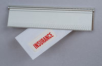 A letter in a mail slot - Insurance