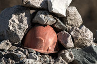 Working helmet on a pile of stones