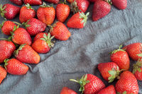 Ripe strawberries on the table on a napkin