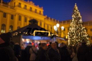 Christmas market in the Advent season in Vienna Schönbrunn Palace. Blurred background