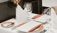Restaurant Table Set Up With Wine Glass And Cutlery
