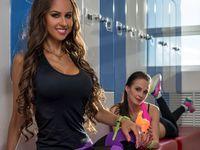 At gym. Charming girls posing in locker room