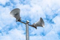 Loudspeakers on sky background