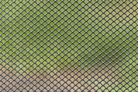 Metal grid with blurred green brown background
