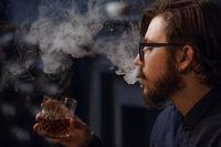 Smoking man drinking whiskey
