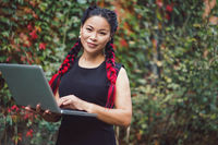 Beautiful Asian Business Woman Posing with Laptop Outdoor