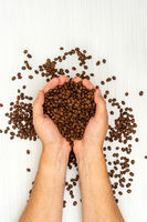 Coffee beans in human hands