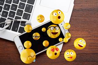 Emoji design with mobile phone.