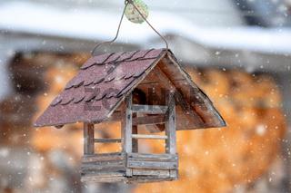 Wooden Bird Feeder in snowy day