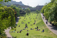 Princes Street Gardens with people sitting in the grass, Edinburgh