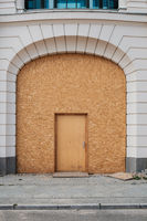 Temporary entrance door , wooden door on beautiful building -