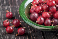 Closeup of red gooseberry in bowl
