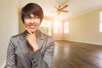 Mixed Race Young Adult Woman In Empty Room of House