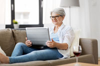 senior woman with on laptop resting at home