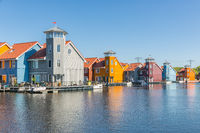 Waterfront with colorful wooden houses in Dutch Reitdiep harbor, Groningen