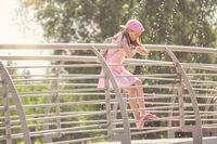 Girl standing on a metal bridge