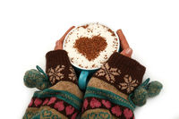 Woman hands hold full latte cappuccino coffee cup