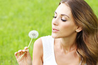 beautiful young woman with dandelion beautiful young woman with dandelion
