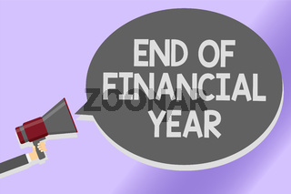 Writing note showing End Of Financial Year. Business photo showcasing Revise and edit accounting sheets from previous year Sound speaker announcement declare lines script text messages ideas.