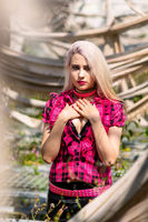 Beautiful woman portrait with punk make up and outfit