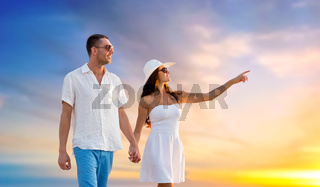 happy couple on vacation walking holding hands