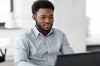 african american businessman with laptop at office