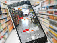 Augmented reality marketing application concept.  Mobile smart phone check relevant information about product in the supermarket.