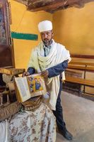 orthodox priest shows a holy bible, Ethiopia