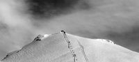 Black and white panoramic view on ski slope and chair-lift