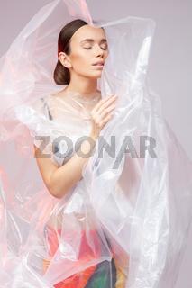 Portrait of a girl in polyethylene. Fashion portrait.