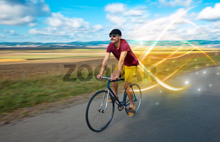 Magical young cyclist riding