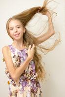 long blond hair of a teenage girl