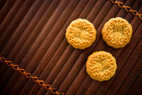 Mooncakes on bamboo mat low light with copyspace