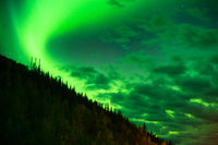 The Northern Lights Shine Up over a Mountainside near Valdez Alaska