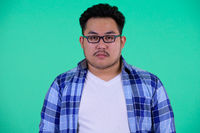 Face of young overweight Asian hipster man