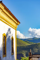 Side view of ancient catholic church with hills and horizon
