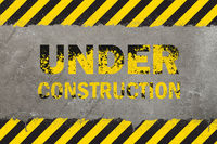 Concrete background with grunge hazard sign