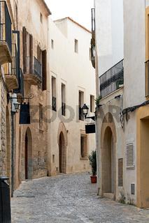 Charming empty cobblestone street of old town of Ibiza (Eivissa), Balearic Islands. Spain