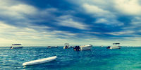 Beautiful view of a sea, boats on the foreground. Amazing landscape. Panorama