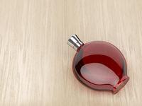 Liqueur bottle on wood background