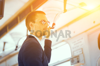 Businessman in metro train.