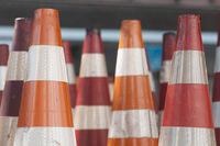 Red and orange traffic cones used to signal construction sites and make detours