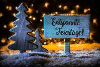 Sign, Tree, Snowflakes, Calligraphy Entspannte Feiertage Means Merry Christmas