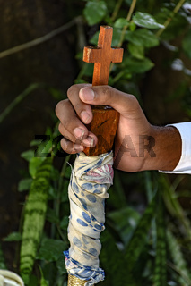 Hands with crucifix