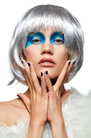 girl in silver wig with blue makeup