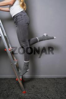 climbing ladder in socks household accident risk