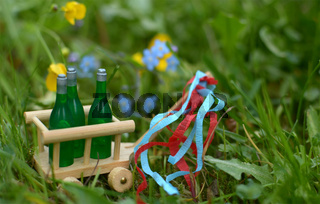 A handcart with three bottles of beer or wine for fathers day
